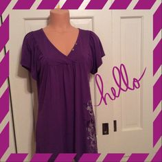 """🌻 Beautiful Purple Top Purple top with floral design is 95% rayon and 5% spandex. Measures 29"""" from shoulder to hem. Good condition with no stains rips or tears. Apt. 9 Tops"""