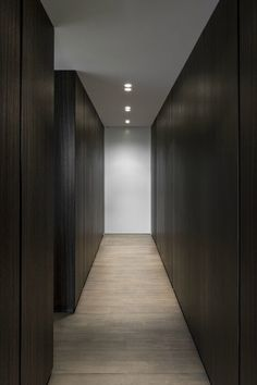 black millwork, light oak flooring