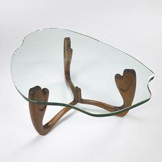 Paul Laszlo  coffee table        Laszlo, Inc.USA, c. 1953 walnut, glass 42 w x 28.5 d x 16 h inches. s4.5