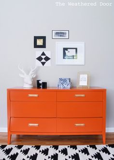 Great mid-century modern dresser makeover from dull brown to vibrant orange. New hardware completes this great look for a hallway, dining room, office or of course bedroom.