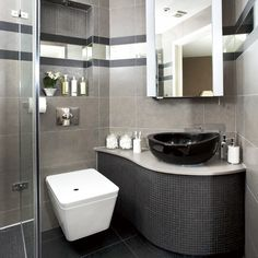 Small black bathroom Understated white sanitaryware provides a ...