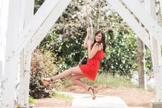 UGA Chapel bell senior swinging pose in Athens, GA | Claire Diana Photography |