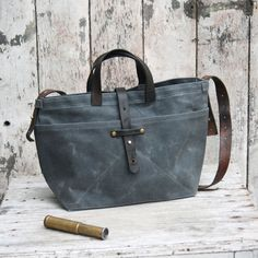 waxed canvas tote in slate by peg and awl | domino.com
