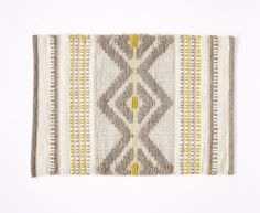 This intricate hand woven wool rug. | 48 Inexpensive Pieces Of Decor That Will Make Your Home Look Fancy