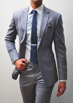 Gray suit + polka dot navy tie + plaid pocket square