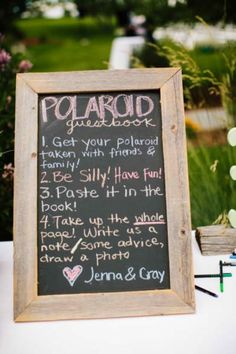 wedding guest book idea- maybe with photo booth photos instead of polaroids, if it's in the budget