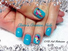 CND Shellac Paradise Collection in Cerulean Sea with Sizzling Sand Additive and Dashing Diva accents. Created by Claire's Creative Nails, Northampton.