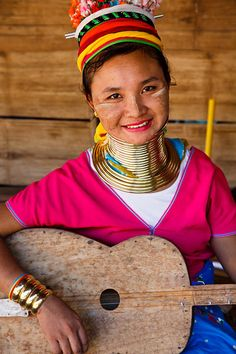 Portrait of a Kayan or Padaung hill tribe woman, more commonly known as the long-neck or giraffe tribe due to brass coils worn around their necks, located in a small village in the Chiang Mai Province