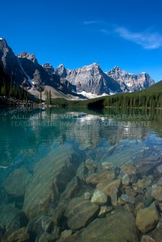 PARADISE FOUND Banff National Park, AB  This image was taken on a day at Moraine Lake when the sky was oh-so-blue, and the water was oh- so-clear; these details allowed me to capture everything from the rocks underwater to the wispy clouds in the sky above.  This was truly a day of 'paradise' at Moraine.