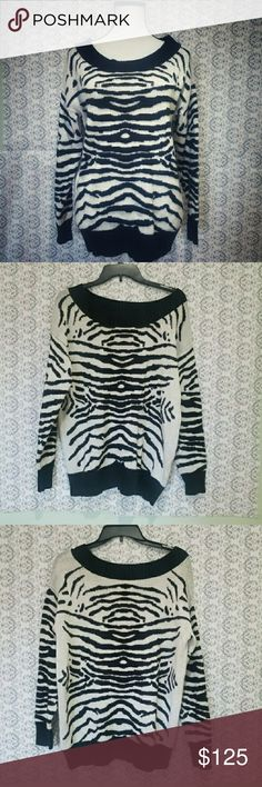 Lord & Taylor 424 fifth zrebra print size large sw Lord & Taylor 424 fifth zrebra print size large sweater pre-owned worn a few times color is black and white in great condition Lord & Taylor Sweaters Crew & Scoop Necks