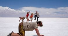 Uyuni Salt Flats in Bolivia are a unique sight in South America on the Alaska to Brazil Overland Tour Funny Beach Pictures, Beach Photos, Cool Pictures, Cool Photos, Illusion Photography, Cute Photography, Creative Photography, Perspective Photos, Perspective Photography