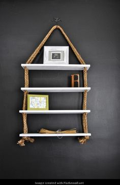 DIY Rope shelves. make it different size shelves to make it look like row boat