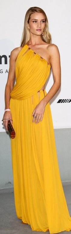 Who made Rosie Huntington-Whiteley's yellow one shoulder gown, jewelry, and red clutch handbag that she wore in Cannes?