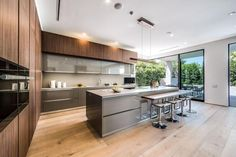 What an amazing blend of old-fashioned wooden cabinets mixed with the futuristic island and counter top style.