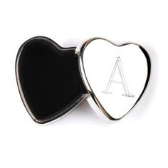 """Delight a friend or loved one with a treasure box meant just for them! Tiny silver heart bears their initial, with a velvet lined secret compartment for a love note or miniature memento.    Assorted letters as follows: A-3, B-3, C-6, D-3, E-3, F-3, G-3, H-3, I-3, J-6, K-6, L-3, M-6, N-3, P-3, R-3, S-3, T-3, V-3, W-3. Each is 1.5"""" x 1.5"""" x 0.75"""" thick. Zinc alloy. Weight 8.4 lbs. each, sold in pack of 72.        Shipping Details for this Item:          Continental U.S. Ground orders placed…"""