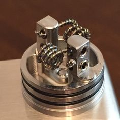 24 gauge kanthal wrapped Clapton style with 0.8 kanthal ribbon and 28 gauge nichrome parralled. On velocity R.D.A riding on Snow Wolf 200 watt mod