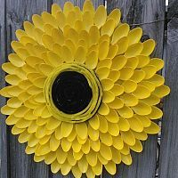 I used 100 plastic spoons to make a sunflower for my backyard. I dug a…