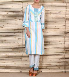 This is a cream, blue and lemon striped cotton kurta with diagonal stripes on the yoke and sleeves with a gold border. It comes with a pair of cream pants with a blue gold border at the bottom.
