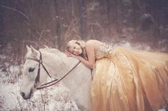 Props to her! Braving the cold in a gorgeous ball gown!