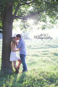 Country couple This is a must have !  something about leaning against a tree and gettin kissed!