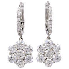 Diamond Flower Earrings on a Diamond Wire   From a unique collection of vintage dangle earrings at http://www.1stdibs.com/jewelry/earrings/dangle-earrings/