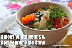 Smoky White Beans and Red Pepper Kale Stew **add some fat or serve with bread and cheese**