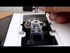 Elna Lotus SP bobbin case repair - Removing a cotton jam from a Elna Sewing machine - YouTube