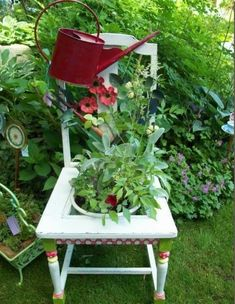 The red watering can on this chair is a nice touch. The painted detail on the legs of this chair are highlighted by the watering can. Simple and charming place for beautiful container plants. Container Flowers, Flower Planters, Container Plants, Container Gardening, Flower Pots, Tin Flowers, Colorful Flowers, Old Chairs, Outdoor Chairs