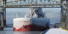 The ice encrusted CSL Assiniboine heads into the Poe Lock.