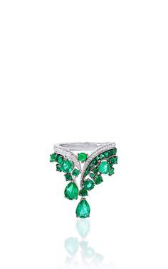 This scintillating ring, intricately embellished with round brilliant diamonds, features lavish Gemfield sourced Zambian emeralds cascading throughout.