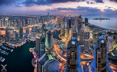 """Dubai Marina through the Nikkor 19mm Tilt Shift Lens - I had the chance to get my hands on the new Tilt Shift lens from Nikon, the Nikkor 19mm f/4 PC. Shot from the 73rd floor of Cayan Tower in Dubai Marina. This is a stitched panorama, 4 blended exposures shot in portrait mode, lens shifted down to the max. Full resolution: 66 Megapixels.  Please check my website for the first ever Rooftopping & Digital Blending workshop in Dubai!  <a href=""""http://www.danielcheongphotography.com/Website..."""