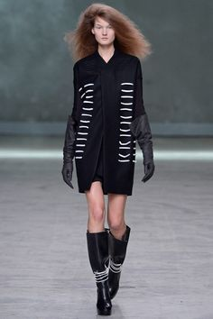"""FALL 2013 READY-TO-WEAR  Rick Owens /   Given the primal, tribal intensity of a Rick Owens show, the designer himself can sound remarkably offhand about what it is that he does. """"I'm known for three things,"""" he said today. """"The big coat, the big boots, the big T-shirt."""" And so he gave them to his public. But if that was all he did, the story would stop here. Of course it didn't, and those """"three things"""" were just components—albeit key ones—in a collection that took Owens somewhere new."""