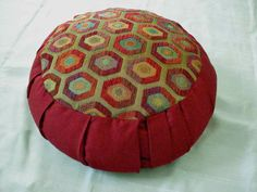 Zafu meditation pillow, beautiful brick red with geometric design. $55.00, via Etsy.