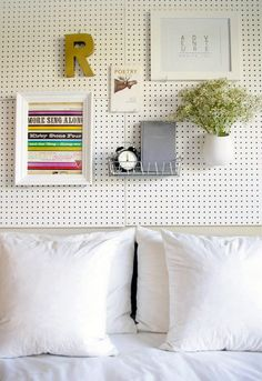 No room for nightstands? Hang pegboard behind the bed! And it comes in sooo many pretty colors and materials too!