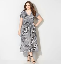 You'll love combining bold graphic looks with the summer style of this new plus size Graphic Swirl Maxi Wrap Dress available in sizes 14-32 online at avenue.com. Avenue Store