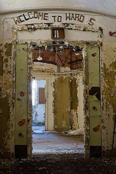 Pilgrim State Hospital. Abandoned Asylum.  Love the sign above the doorway.