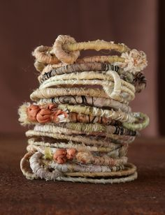 Textiles Jewellery - pretty fabric ribbon & thread wrapped bracelet stack; lovely colours and textures //  Kelly McKaig
