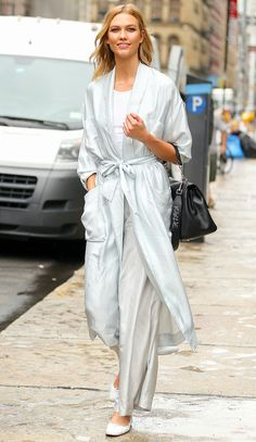 16 Times Karlie Kloss Killed It in Flats | People - in palazzo pants and a robe by Zimmermann and Repetto ballet flats with her favorite Carolina Herrera bag.