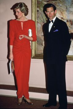 1985 - In addition to Walker, Bruce Oldfield also frequently dressed Diana through the '80s. She wore this ruched number to the National Gallery in Melbourne.   GETTY