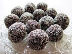 Chocolate coconut balls are simple, but delicious desserts. You just have to combine the ingredients, shape balls and roll them into shredded coconut.