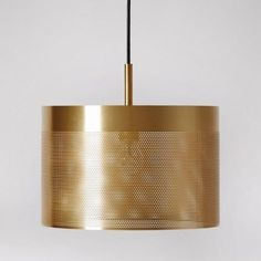 The Gato lighting pendant in brass. This pendant light is spot on. The Gato's brass-plated shade is perforated with delicately drilled holes – discreet in the daytime, but at night they allow cheeky rays of light to peep through. Gorgeous. Obsessed? Us? You bet.