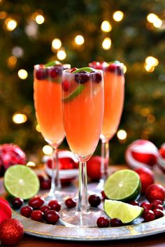 Celebrate the holidays with Christmas Mimosas! A fun twist on a traditional mimosa that's perfect for Christmas. Make Christmas Mimosas, Christmas Mimosa Punch, and Christmas mocktails with this easy recipe.