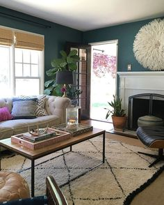 For this week's #smallspacesquad I want to debunk the myth that you can't use a dark paint color in a small space. @sgardenerstyle painted her living room this dreamy rich shade of peacock and it is beyond perfect! So moody yet so airy and fresh. I'm sort of obsessed... Also am I the only person who calls this color peacock? PS - be sure to check out @ericareitman 's pick this week keep using our tag for your chance to be featured on #smallspacesaturday via instagram