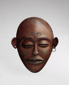 Pwo mask Date: 19th–early 20th century Geography: Angola Culture: Chokwe peoples Medium: Wood, leather, metal Dimensions: H. x W. x D.: 7 5/8 x 6 1/2 x 2 1/8 in. (19.4 x 16.5 x 5.4 cm)