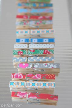 Clothespins with Petit Pan Printed paper http://www.petitpan.com/181-papeterie