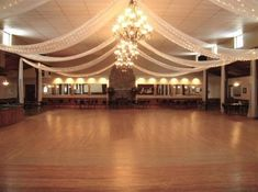 Reception Hall - for a more colorful theme, I will use white tulle with multi-colored string lights on white wire rather than white lights. Tulle Decorations, Wedding Hall Decorations, Wedding Draping, Wedding Venues, Wedding Halls, Wedding Ideas, Reception Halls, White String Lights, Dream Wedding