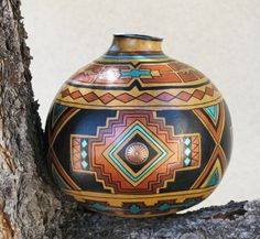 Hey, I found this really awesome Etsy listing at https://www.etsy.com/listing/239962489/southwestern-hand-painted-gourd-pot-681
