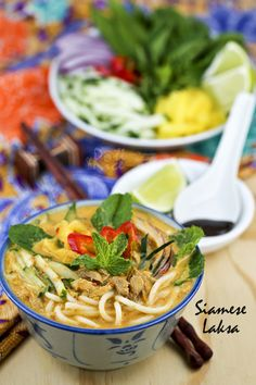 This super tasty Siamese Laksa is a spicy fish and coconut based rice noodle soup. It is a must try when visiting Malaysia! #malaysianfood #noodles #laksa