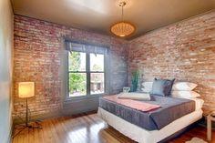 Exposed brick + hardwood floors. Love!