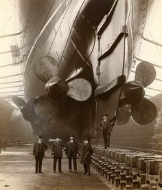 """Mauretania  This photograph is taken in Canada Dock in Liverpool, 1909. The gentleman in uniform is """"Mauretania's"""" first Chief Engineer, John Currie.   RMS MAURETANIA was one of the most famous ships ever built on Tyneside"""